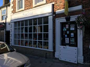 Barrier fitted to front of Precious shop